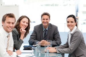 Portrait of a positive team sitting at a table during a meeting